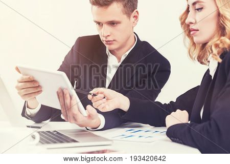 Business People With A Tablet In Office
