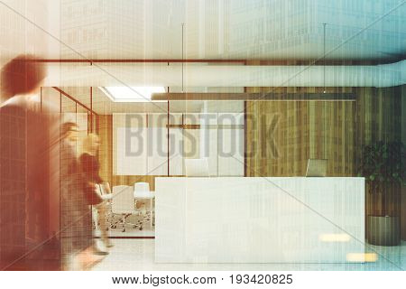 Wooden wall office interior with a concrete floor glass walls a tree in a pot a meeting room and a white reception counter with laptops on it. People. 3d rendering mock up toned image double exposure