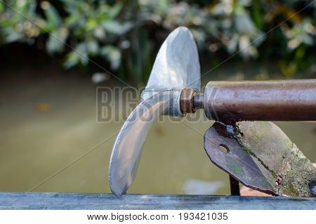 Metall propeller of asian long tail boat. Closeup view