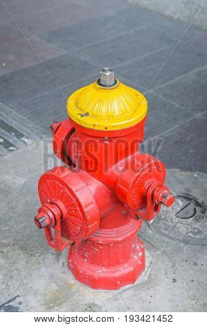 Brightly Colored Fire Hydrant - Photograph of a fire hydrant painted bright yellow and red