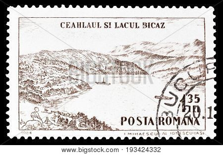 ROMANIA - CIRCA 1964 : Cancelled postage stamp printed by Romania, that shows Ceahlau Massif and Lake Bicaz.