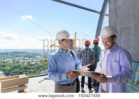 Architect Explain Project Plan To Builder Contractor On Constuction Site, Building Business Concept