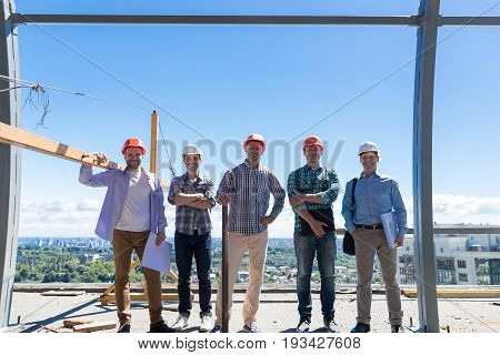 Team Of Builders On Costruction Site, Happy Smiling Foreman Group In Hardhat Outdoors Teamwork Concept