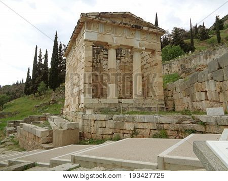 The Treasury of the Athenians on the Hillside of the Archaeological Site of Delphi, Greece