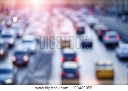 Blurred photo of roads and cars with glowing lights