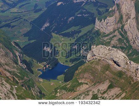 Blue lake Seealpsee rock layers. Summer scene in Appenzell Canton Switzerland.