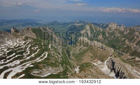 View from Mount Santis towards Appenzell. Lake Seealpsee.