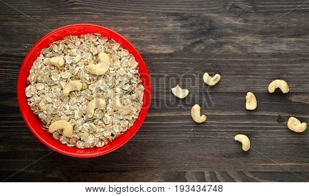 Oatmeal With Nuts Cashews . Oatmeal On A Wooden Table. Oatmeal Top View. Healthy Food