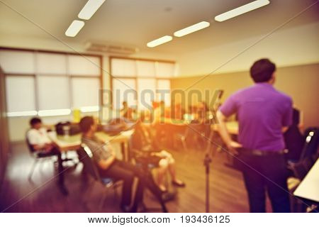 Abstract Blur Education Meeting, Business, Student And People In Classroom In University. Teacher Le