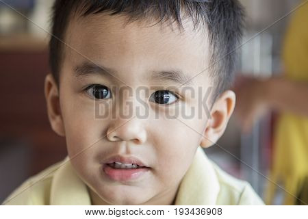 close up eyes looking to camera and face of one year old asian toddle