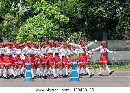 KOLKATA WEST BENGAL / INDIA - AUGUST 15TH 2016 : White dressed young girls marching past on road to celebrate India's Independence day. The day is celebrated all over India with huge enthusiam and joy.