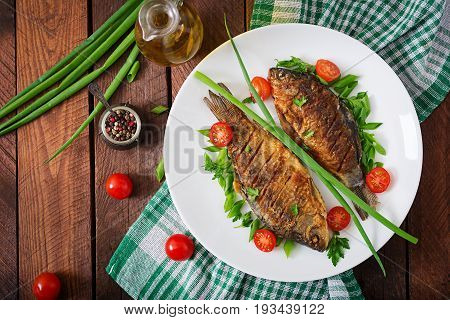 Fried Fish Carp And Fresh Vegetable Salad On Wooden Background. Flat Lay. Top View