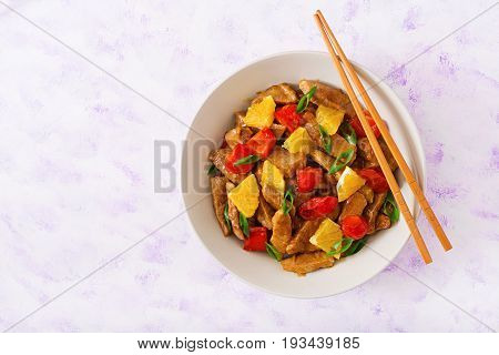 Veal Fillet - Stir Fry With Oranges And Paprika In Sweet And Sour Sauce On A Light Background. Flat