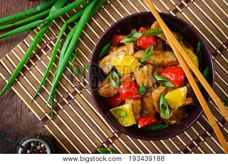 Veal Fillet - Stir Fry With Oranges And Paprika In Sweet And Sour Sauce On A Wooden Background. Flat