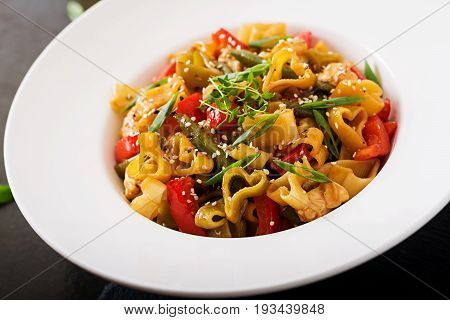 Stir Fry From Chicken Fillet, Green Beans And Paprika With Pasta In The Form Of Heart
