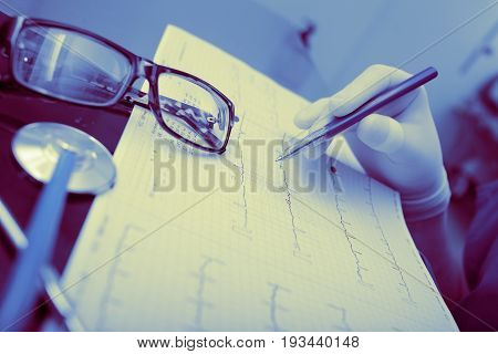Doctor work with medical documents.Medical examination results work