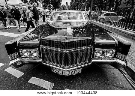 BERLIN - JUNE 17 2017: Full-size luxury car Cadillac Coupe de Ville 1970. Black and white. Classic Days Berlin 2017.