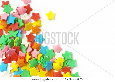 sugar sprinkling star shaped multicolored on white background festive horizontal composition