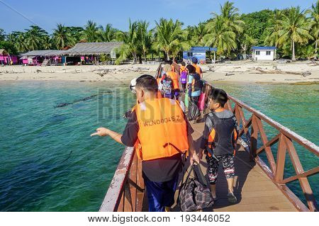 Labuan,Malaysia-May 1,2017:An unidentified people visiting at Rusukan Besar island in Labuan,Malaysia.It is very popular place for tourist to visit & also for those who like snorkeling underwater