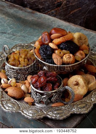 A Composition From Different Varieties Of Dried Fruits On A Wooden Background - Dates, Figs, Apricot