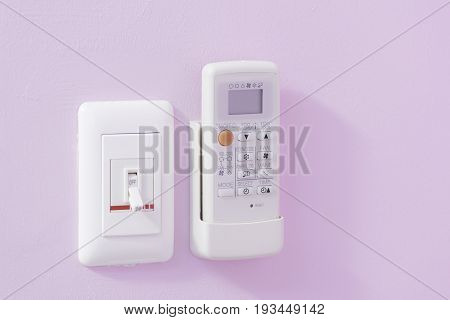 Electric Breaker and Remote Air Conditioner on the wall.