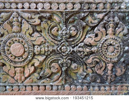 Gorgeous pattern of the medieval carved stone wall in Prasat Hin Phanom Rung Ancient Khmer Temple, Buriram, Thailand