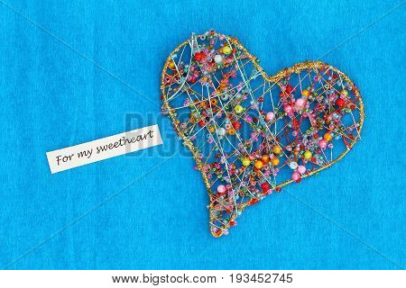 For my sweetheart card with heart made of colorful beads on blue surface