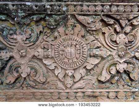Beautiful pattern of medieval carved rough sandstone wall in Prasat Hin Phanom Rung Ancient Khmer Temple, Buriram, Thailand