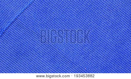 Blue microfiber cloth texture background for cleaning, auto detailing and valeting concept design.