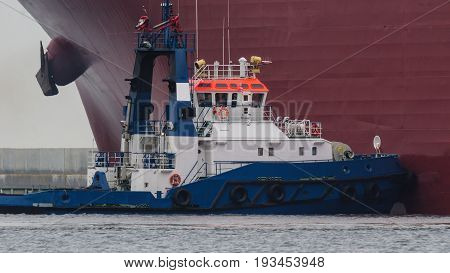 LNG TANKER - Tugboat at the side of the ship