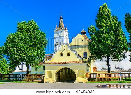 Street view of the Fortified church of Harman, Brasov in Romania.The fortress is located in the middle of Harman, a village 8 km far from Brasov. It dates back to the 13th century when the Saxons built the original church