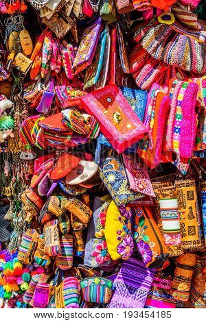 Colourful goods for sale in souvenir shop in Ollantaytambo, Peru. Ollantaytambo is a town and an Inca archaeological site in Peru.