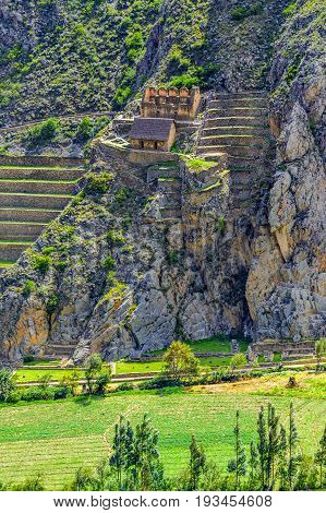 Inca Fortress with Terraces and Temple Hill in Ollantaytambo, Peru. Ollantaytambo was the royal estate of Emperor Pachacuti who conquered the region