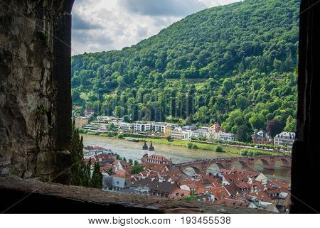 Plenty Of Residential Houses At The Hillside At The Embankment Of Neckar River And A Bridge At The C