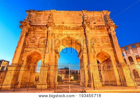 The Arch of Constantine next to the Colosseum in Rome, Italy