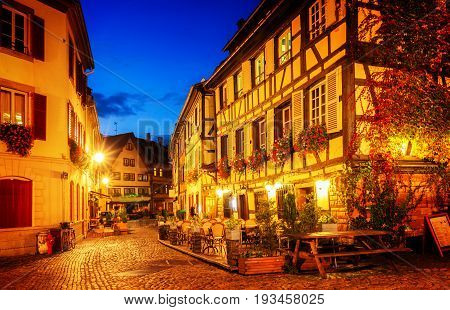 street of Petit France medieval district of Strasbourg at night, Alsace France, retro toned