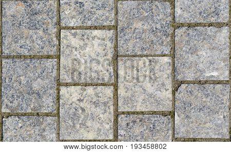Grey Stone pavement texture. Granite cobblestoned pavement background.