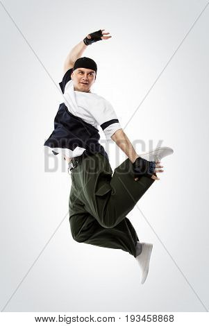 Hip-hop dancer jumping, isolated on white with clipping pach. Studio shoot.