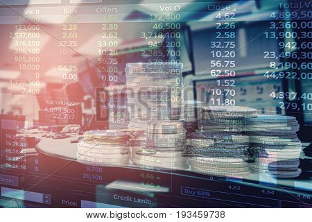 Double exposure stack of coins and business stock trading room with computer and graph for Business Trading concept.