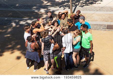 LYON, FRANCE - JUN 10, 2017: A mixed group of young people go through a team bonding ritual