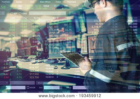 Double exposure of business man with glasses in hipster shirts holding tablet for check stock market graph with stock and computer graph background Business Trading concept.