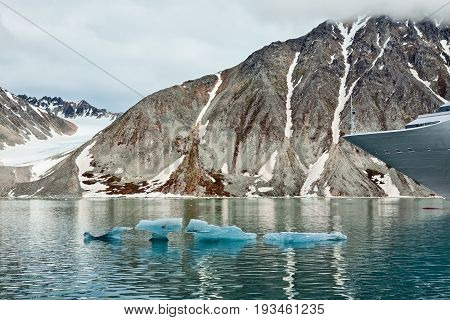 Cruise ship in Magdalenafjord in Svalbard islands Norway