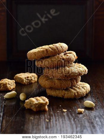 Peanut butter cookies on a black background, vertical