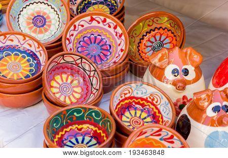 Colorful ceramic bowls at the tourist market on the Plaza de la Reina in Valencia