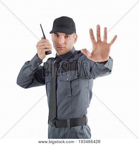 Security man shows by hand stop and speaks by walkie-talkie