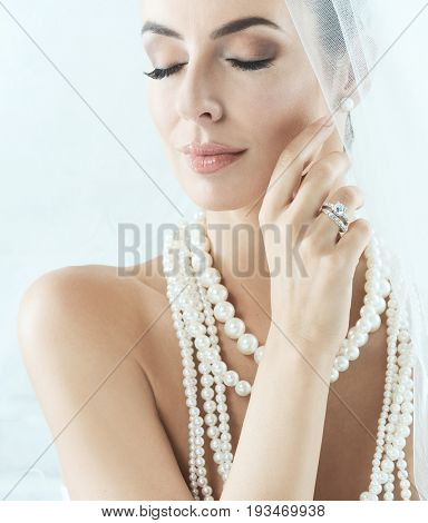 Portrait of beautiful young bride eyes closed.