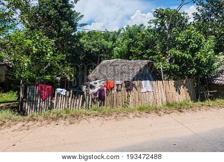 Toamasina Madagascar - December 22 2017: Traditional houses in Madagascar's countryside near Toamasina (Tamatave) Madagascar East Africa. People in Madagascar suffer of poverty due to the slow development of the country.