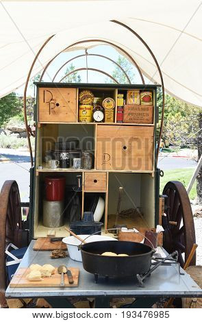 CODY, WYOMING - JUNE 24, 2017: Chuckwagon at Buffalo Bill Center of the West. Daily cooking demonstrations and tastings are provided by staff in front of the museum.