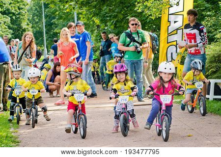 Russia. Moscow. Vorontsovsky Park on the 21st of August. STRIDER CUB 2016. Racing on the balance bike. Small riders are getting ready for the start