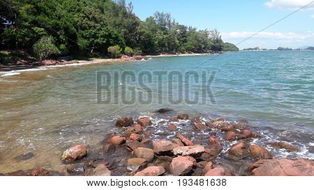 Pink stone and the blue sea on the east coast of Thailand